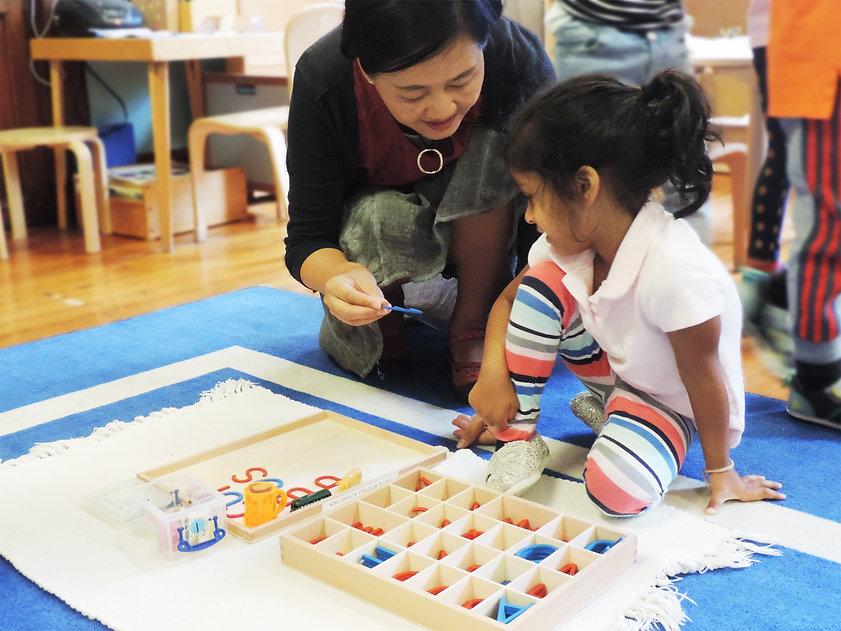 Teacher helping student with language skills