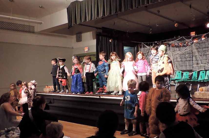 "A Primary class performs a play based on ""A Picnic at Mudsock Meadow"" by Patricia Polacco."