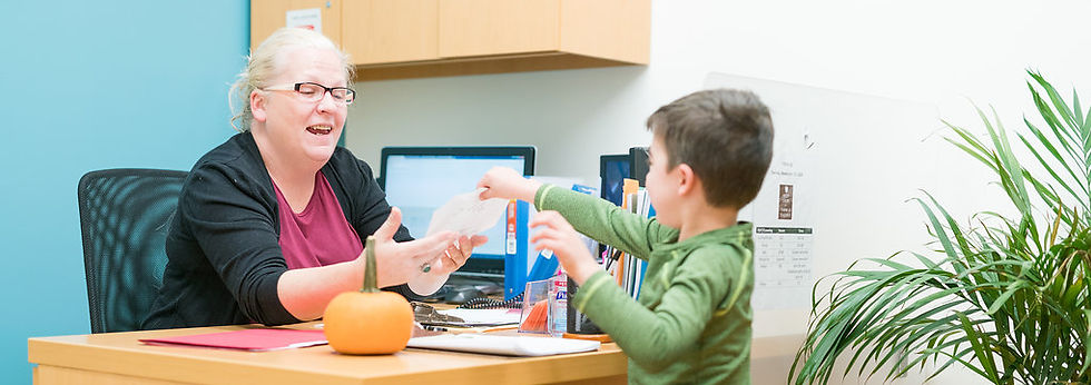 Child showing his work to Administrator