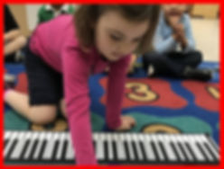 girl piano red background.jpg
