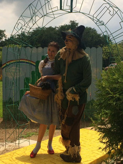 Scarecrow and Dorothy at Emerald City