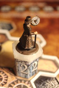 Clockmaker on Column-Token