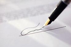 black pen signing a signature