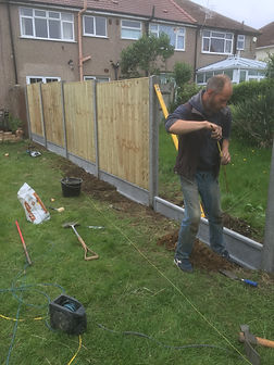 workman doing fencing