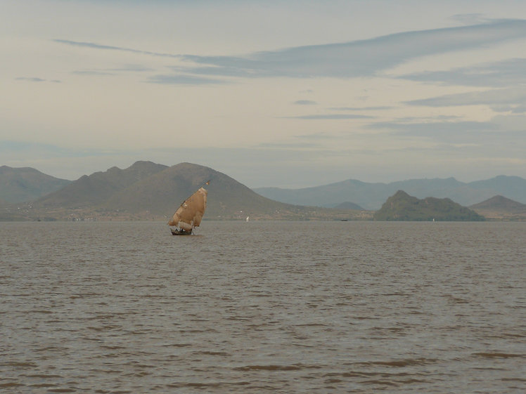 Sail boat on LV with moutains - kenya -