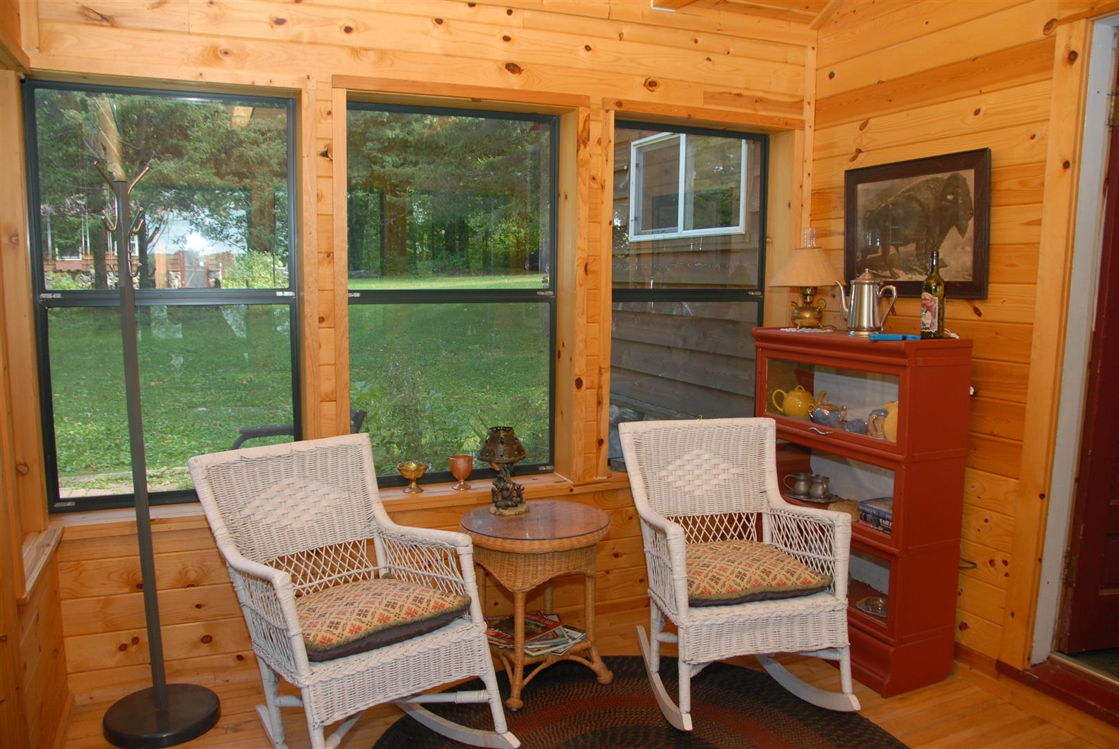 Rocking chairs on enclosed porch
