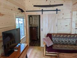East bedroom entry with barn door