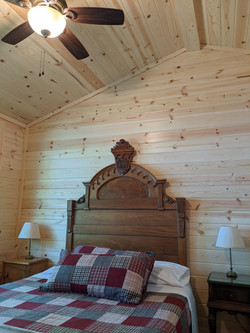 Oak headboard and vaulted ceiling in north BR
