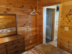 """East bedroom entry and """"closet"""" area for hanging clothes"""