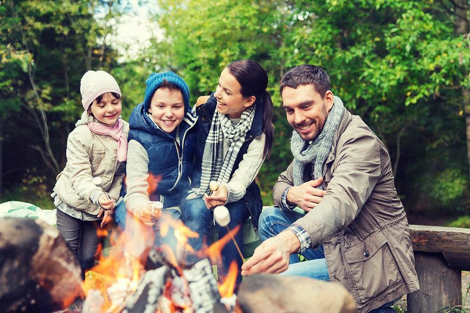 family enjoying basecamp fire.jpg