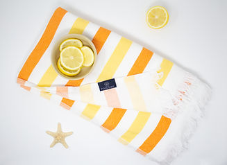 Orlando product photography shot of Hello Poolside Turkish Towel with a bowl of lemons and starfish props
