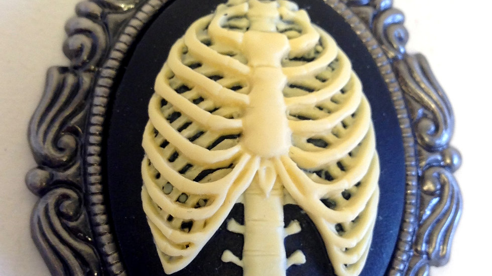 Creme Ribcage on Black Cameo with Ribbon