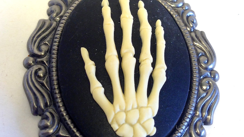 Creme Skeleton Hand on Black Cameo with Ribbon
