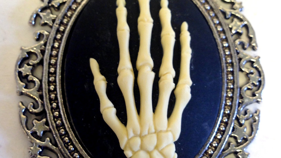 Creme Skeleton Hand on Black Cameo