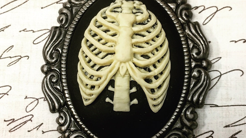 White Ribcage on Black Cameo