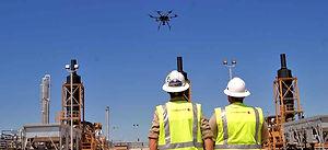 workers-watching-drone_edited.jpg