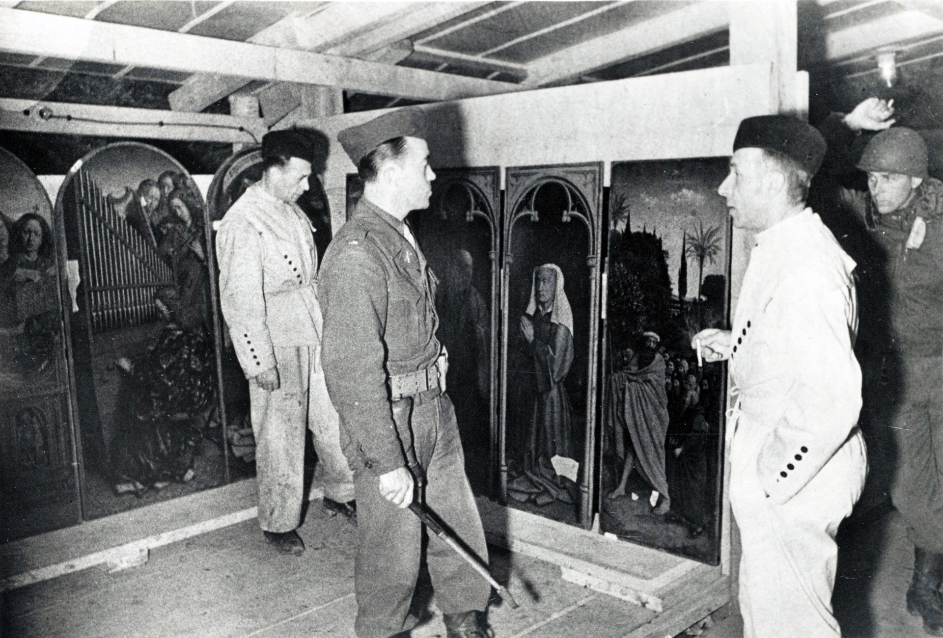 U.S. military officers examining the looted altarpiece 'the Adoration of the Mystic Lamb' at Altaussee Salt Mine