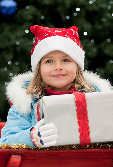 Little Girl with Christmas Present
