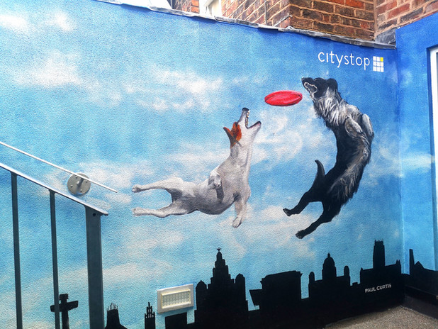 Two dogs, city stop apartments mural