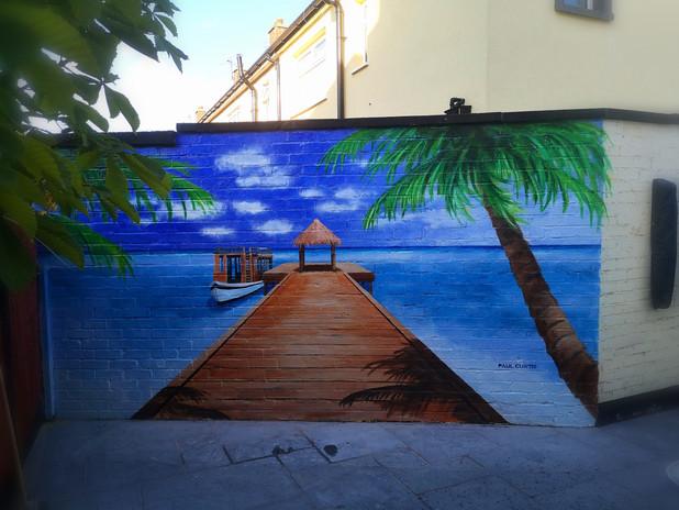 Beach mural painted by Paul Curtis