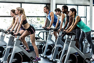 50602922-fit-people-working-out-at-spinn