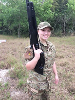 girl holding massive firearm
