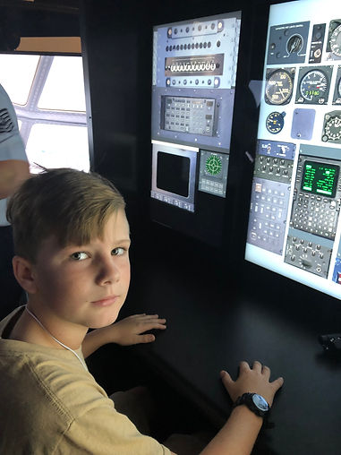 Kid in aerospace simulation training room