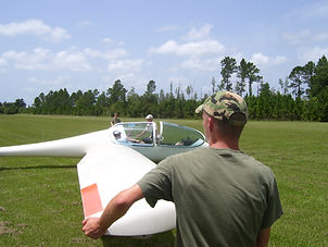 Army holding wing of a Small Plane