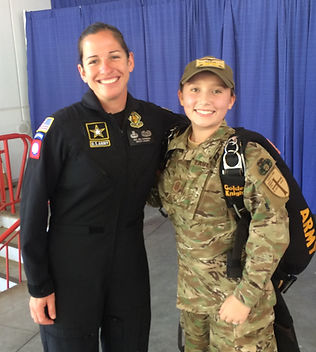 Golden Knight Spc Jen Espinosa with Eagle Cadet Chief Master Sgt Gonzalez