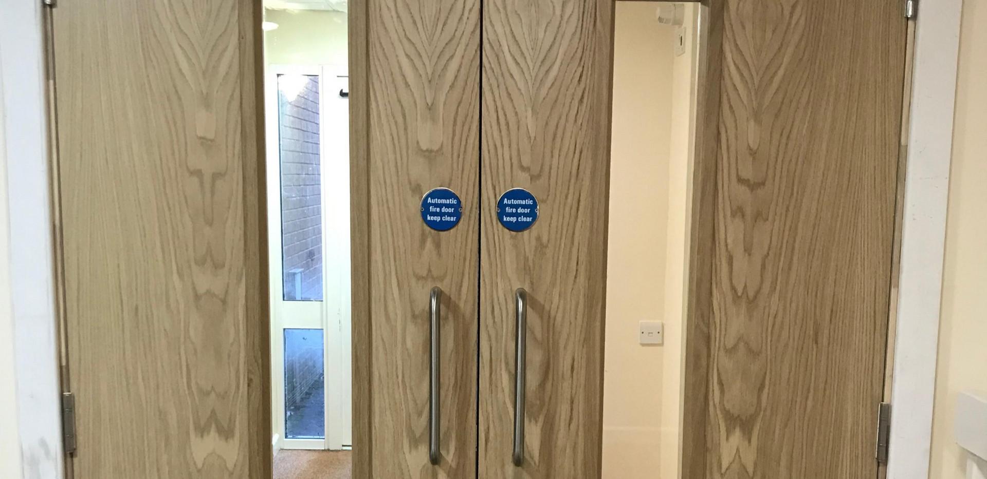 FD30 Oak doors with windows and ironmongery