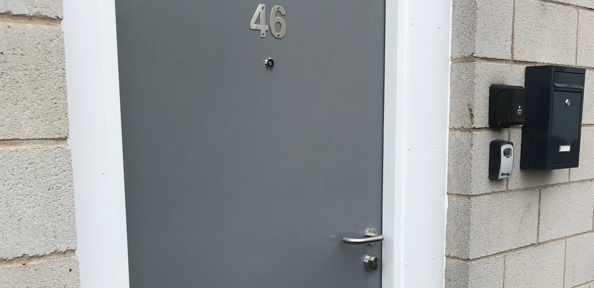 Flat external fire door