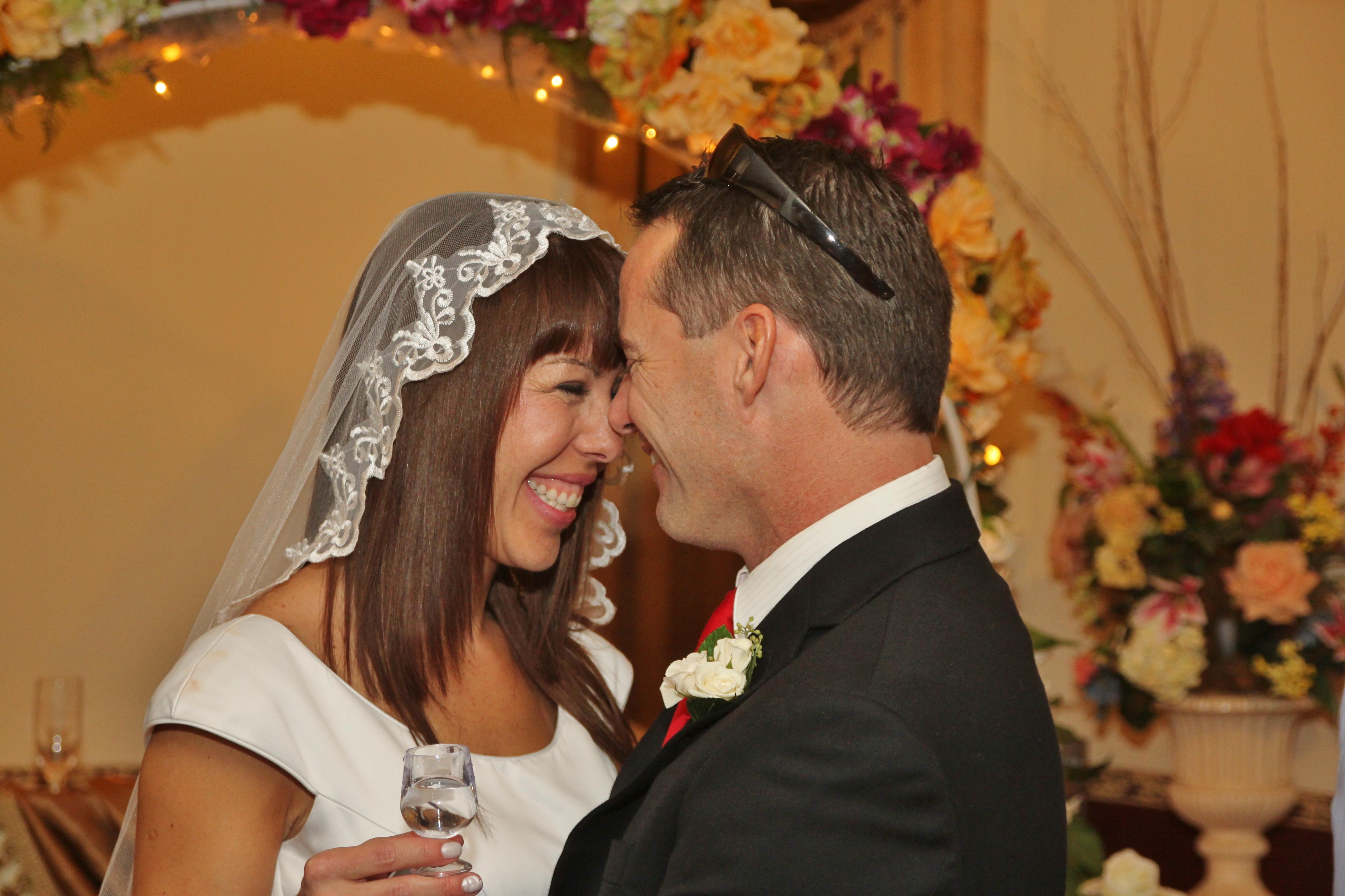 smiling bride groom chapel