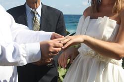 exchanging rings beach wedding