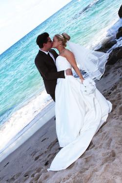 Bride groom beach wedding kiss