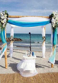 beach wedding bamboo arch sand ceremony