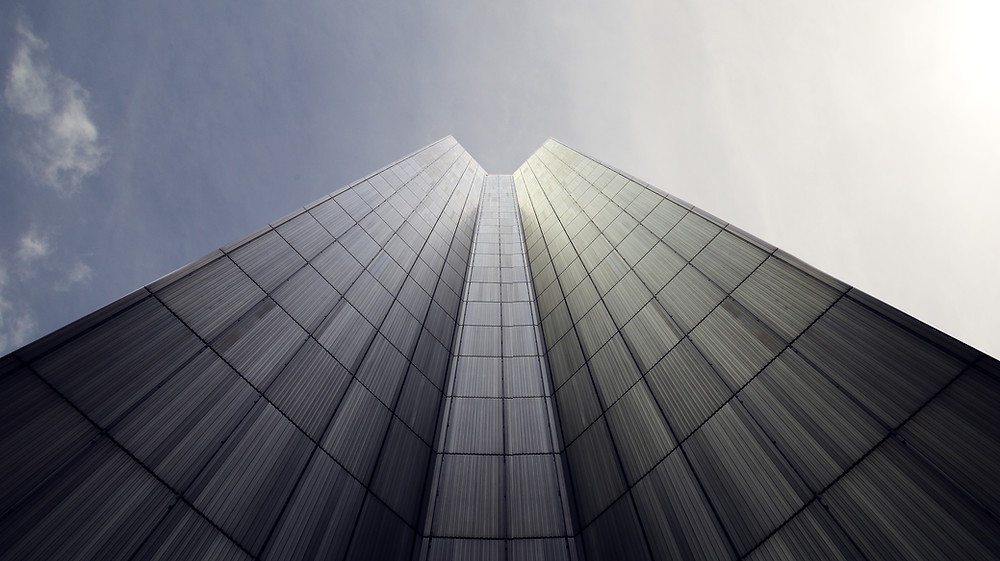 A tall office building reaching into the sky