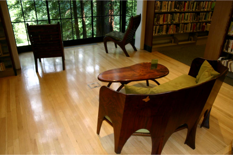 claro walnut loveseat, small table, two reading chairs. Mill Valley public library