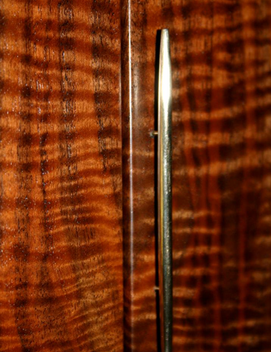 close up/ brass handle with spectacular california walnut