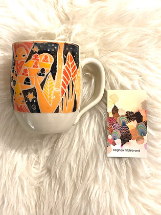 Carved and hand painted Yukon-themed ceramic mug by Meghan Hildenberg