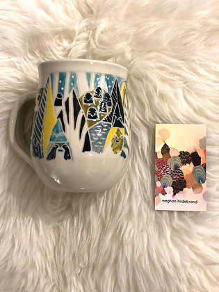 Carved and hand painted Yukon-themed ceramic mug by Meghan Hildebrand