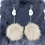 Thumbnail: Wolf pom & antler statement earrings by Erin Profeit