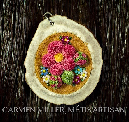Beaded and tufted floral antler pendant by Carmen Miller