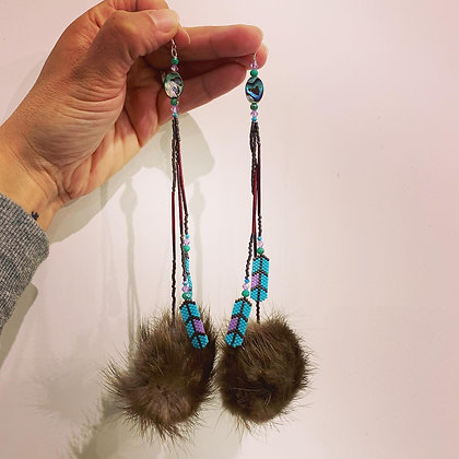 Beaded delica feathers & beaver pom earrings by Rayven Svendsen