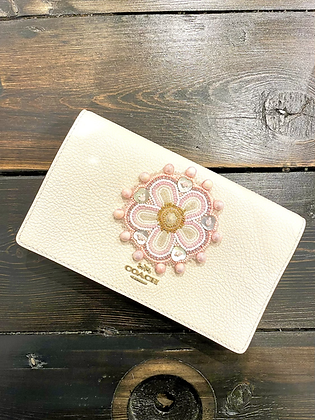 Coach clutch with beaded floral by Marilyn Jensen