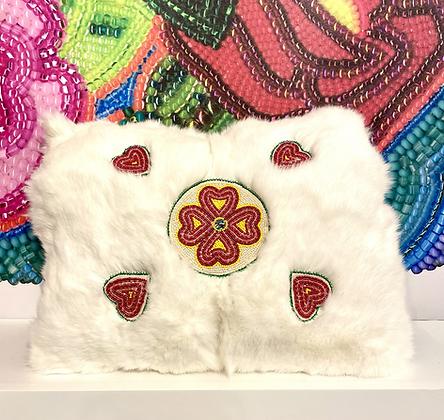 Beaded hearts fur decor pillow by Lisa Dewhurst
