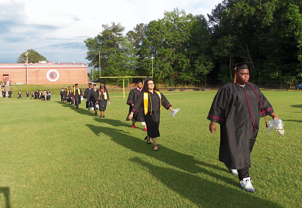 Approximately 100 AHS students walked on to the football field at AHS for their graduation program.