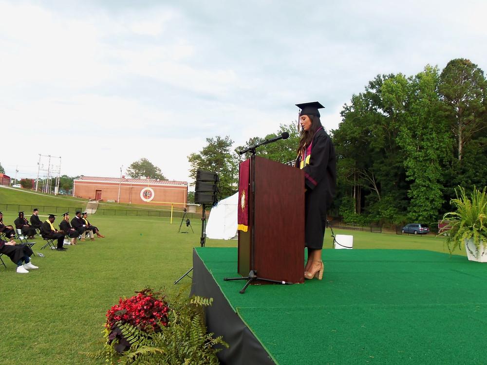 Meg Botts gave the valedictory address at the recent AHS graduation, held on the school's football field.