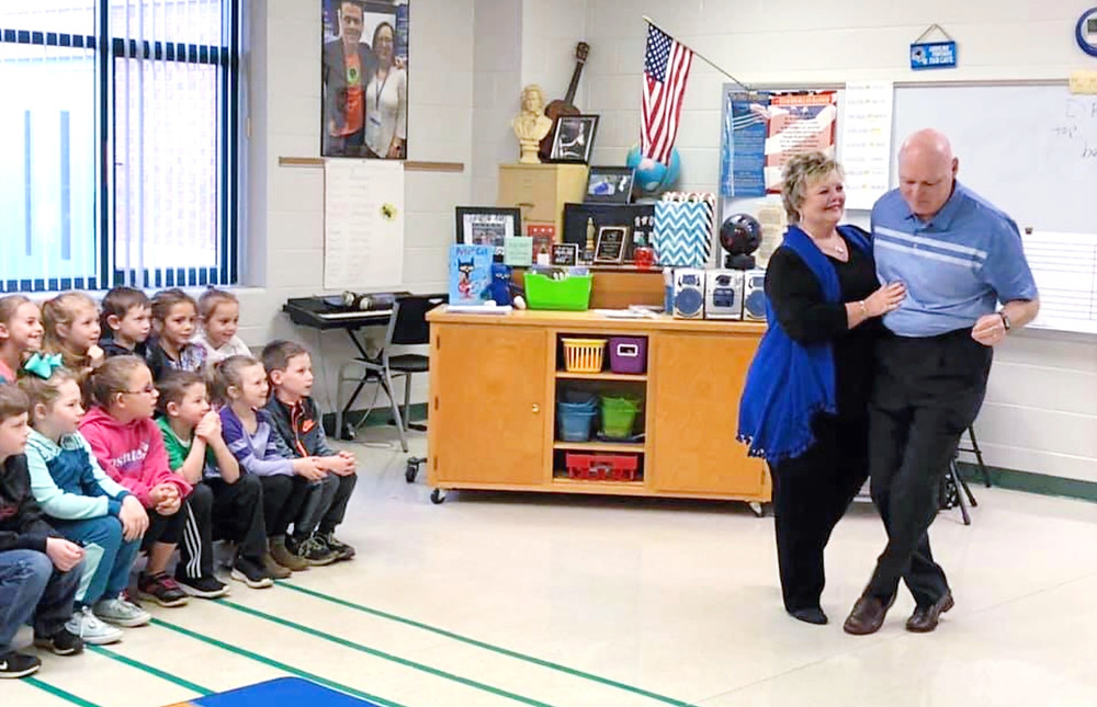 The late Dr. Betty Jo Hall dancing with her husband, Dr. Wally Hall, for Abbeville County students in the classroom.