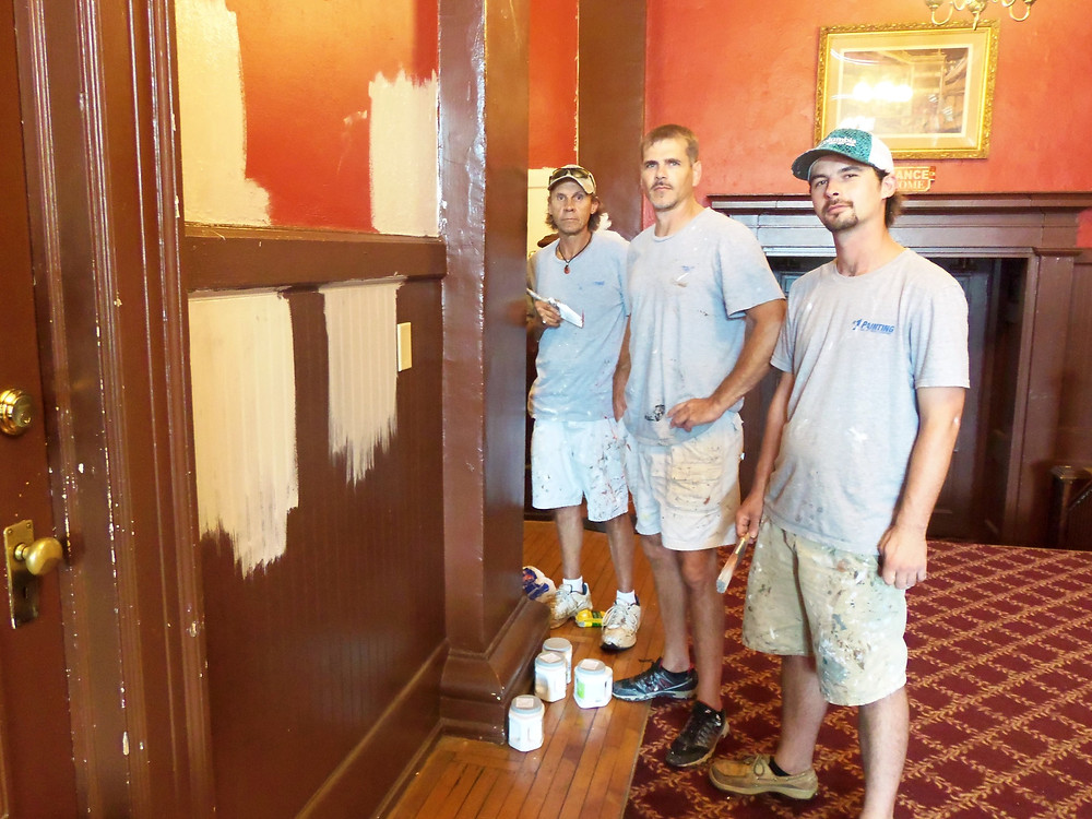 (From left) Ray Bowie, Jeremy Creswell, and Austin McCurry of #1 Painting showed off some of their colorful work in the lobby of the Abbeville Opera House.