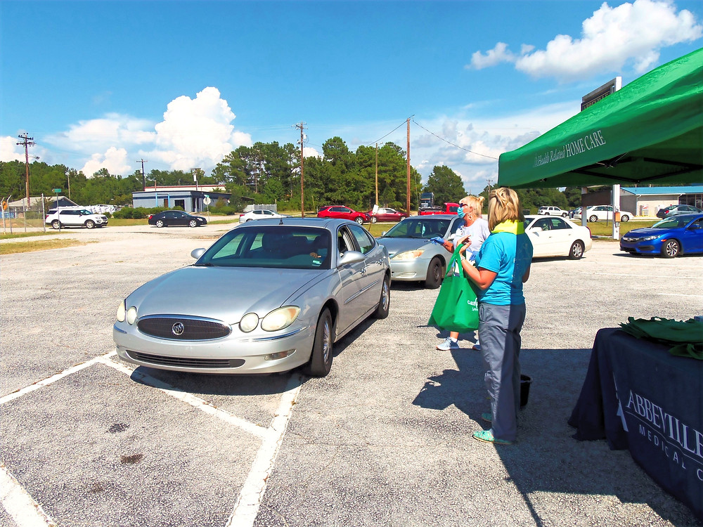 Personnel from AAMC were among those on hand for a drive-thru health fair.